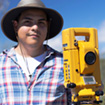Archaeology student with surveying equipment
