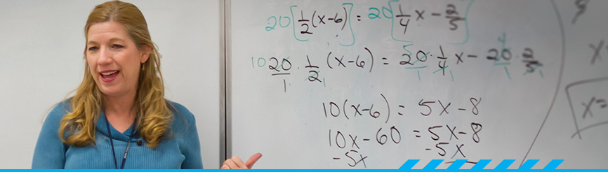 Math instructor at white board in PCC classroom