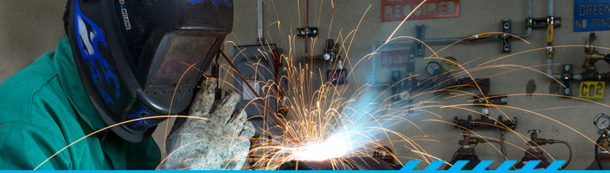 Student working on welding project